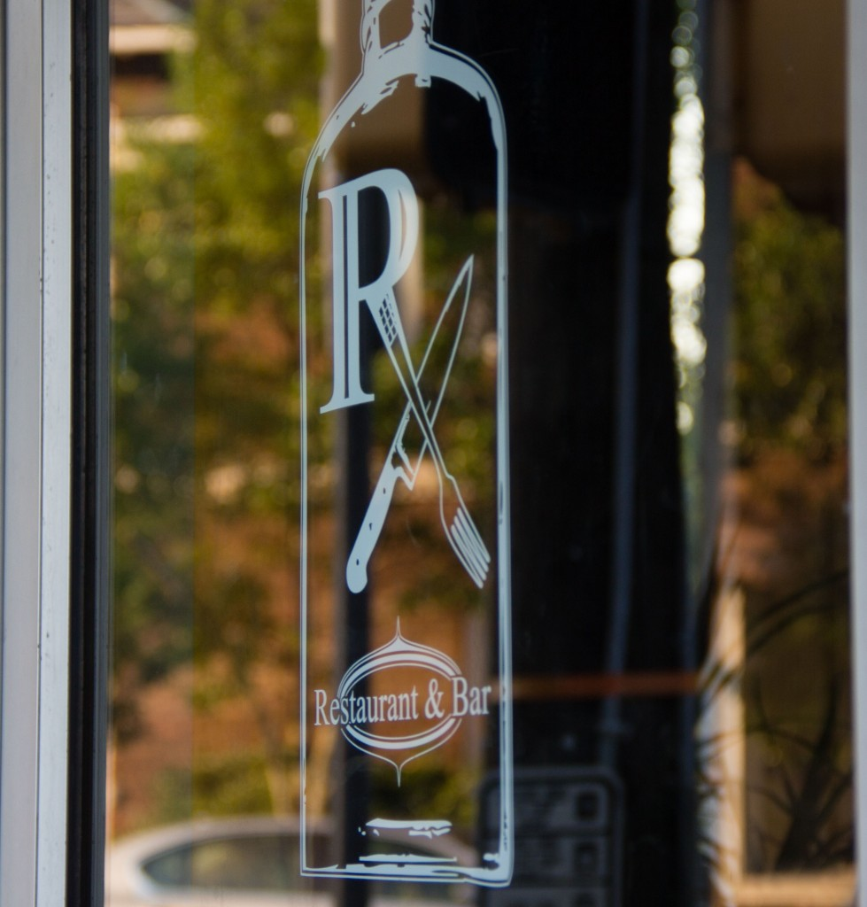 The Rx logo on the front window.